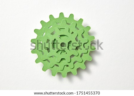 Stack of papercraft clockwork mechanism from color paper. Stock photo © artjazz