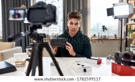 male blogger with camera videoblogging at home Stock photo © dolgachov