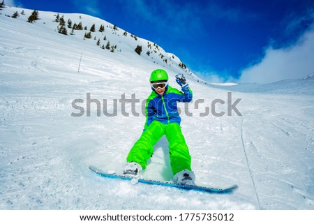 Little cute boy snowboarding. Activities for children in winter. Children's winter sport. Lifestyle Stock photo © galitskaya