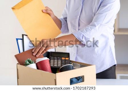 Stress of business woman packing brown cardboard box her belongi Stock photo © snowing