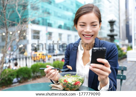Happy Asian woman texting sms on mobile phone in New york City, NYC. Young girl walking in Central P Stock photo © Maridav
