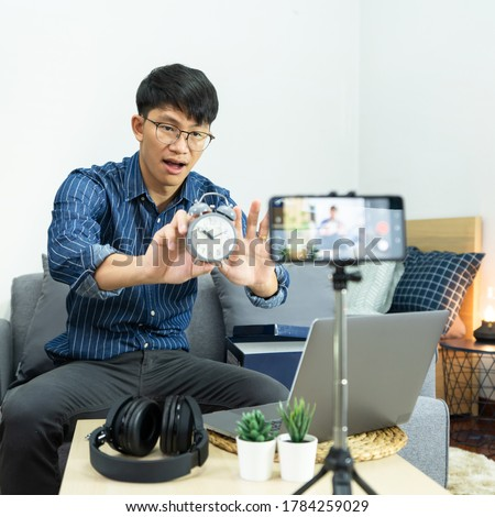 Asian man online influencer recording video live streaming, usin Stock photo © snowing
