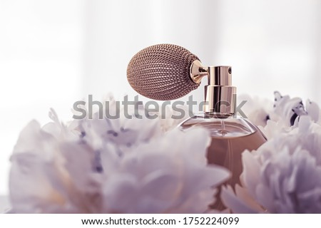 Violet fragrance bottle as luxury perfume product on background of peony flowers, parfum ad and beau Stock photo © Anneleven