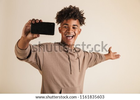 Photo of african american man taking selfie and gesturing peace sign Stock photo © deandrobot