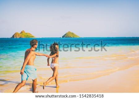 Zomervakantie zonnebrand paar holding handen Hawaii Stockfoto © Maridav