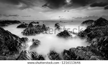 view of a misty ocean in the morning long exposure shot vertic stock photo © moses