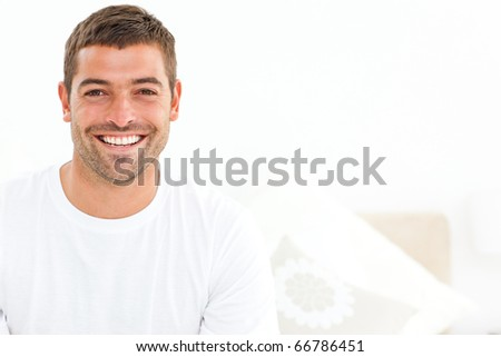 Cheerful man stting on his bed at home and smiling at the camera stock photo © wavebreak_media