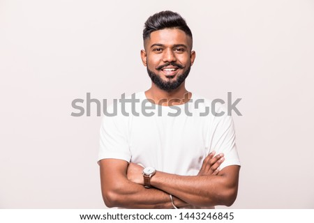 Young male standing with arms folded against a white background stock photo © wavebreak_media