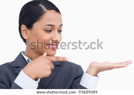 Close up of saleswoman looking at her palm against a white background stock photo © wavebreak_media