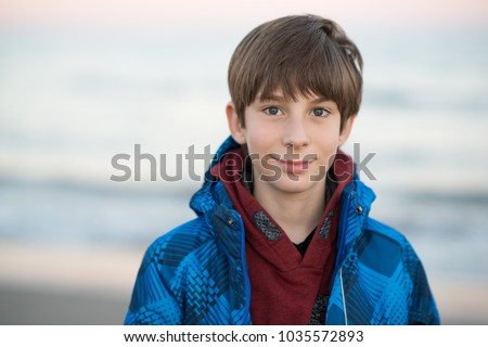 young happy boy looking handsome at the beach Stock photo © meinzahn
