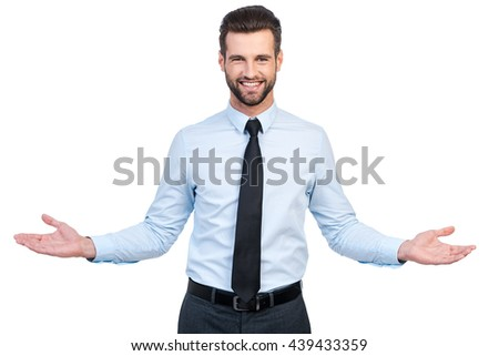 Handsome young businessman with outstretched hand against cloudy sky Stock photo © Nejron
