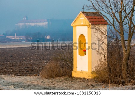 God''s torture with sunflower field and Jaroslavice Castle, Czec Stock photo © phbcz