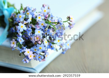 Book with flowers forget-me-not on the vintage book and croissants Stock photo © laciatek