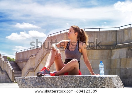 Athlete woman standing after sport exercising on the rocks by th Stock photo © vlad_star
