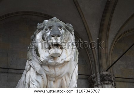 lion statue in front of feldherrnhalle at the odeonsplatz munic stock photo © meinzahn