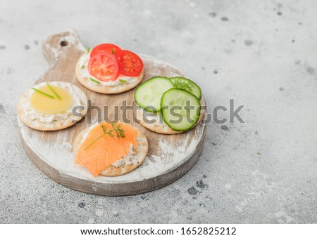 Slice of salmon with cherry tomatoes and cracker in restaurant.  Stock photo © Yatsenko