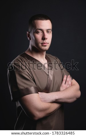 Masseur. Specialist for massage. massage table. strong man of ch Stock photo © popaukropa
