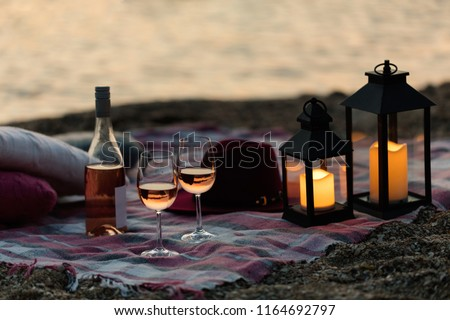 Two glasses of champagne. Picnic on the beach at sunset in the w stock photo © Yatsenko
