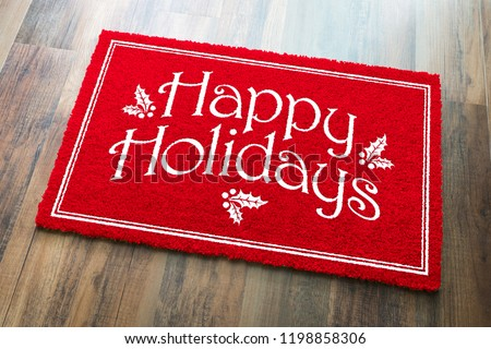 Happy Holidays Christmas Red Welcome Mat On Wood Floor Backgroun Stock photo © feverpitch