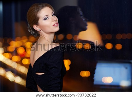 Young ellegant woman standing on the ligths of the night city background. Freedom and girl in love c Stock photo © artfotodima