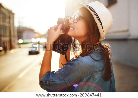 Beautiful Tourist Woman Taking a Picture Outdoor in City Street by Digital Camera Stock photo © artfotodima