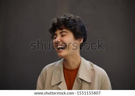 фото красивая женщина 20-х годов вьющиеся волосы смеясь Сток-фото © deandrobot