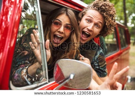 Photo of amusing hippie couple smiling, and fooling around while Stock photo © deandrobot