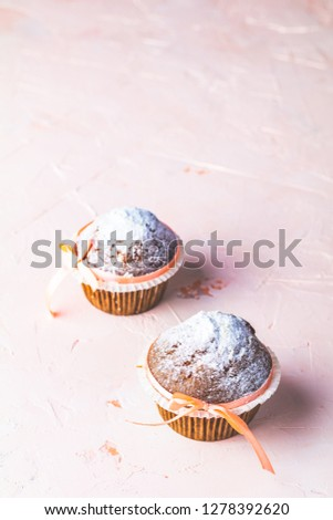 Tasty delicious homemade muffin on light pink living coral stone Stock photo © artsvitlyna