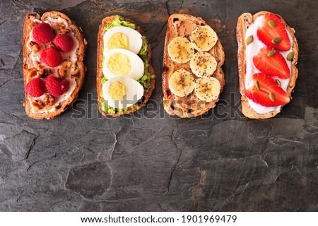 Natural yogurt with strawberries, peanut butter toast and apple. healthy breakfast stock photo © zoryanchik