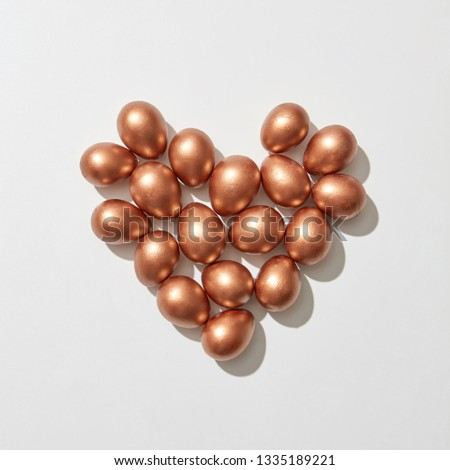 Golden painted eggs in the shape of a heart on a gray background with copy space. St. Valentine's Da Stock photo © artjazz