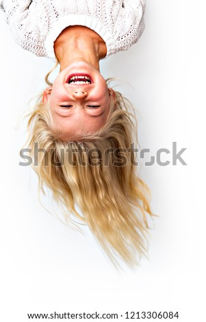 Cute girl 4-5 year old posing in studio upside down with love glasses Stock photo © Lopolo