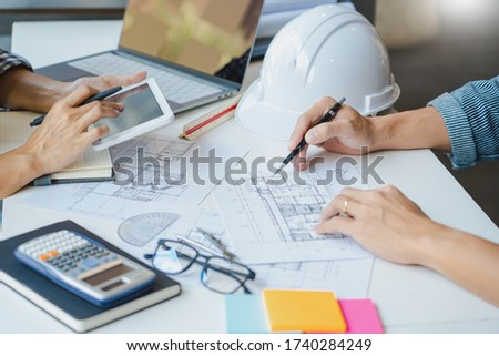 persons engineer hand drawing plan on blue print with architect stock photo © snowing