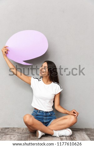 Happy woman wearing casual clothing holding blank balloon with c Stock photo © deandrobot