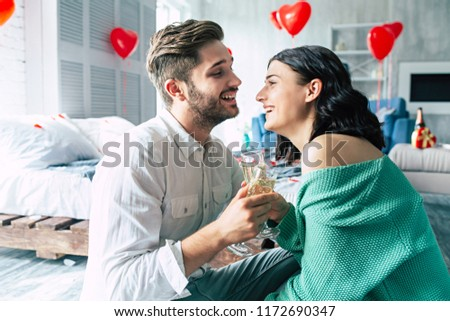 Young couple with two glasses of white wine in bed on the blurre Stock photo © dashapetrenko