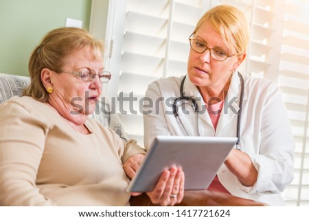 Doctor or Nurse Talking to Senior Woman with Touch Pad Computer Stock photo © feverpitch