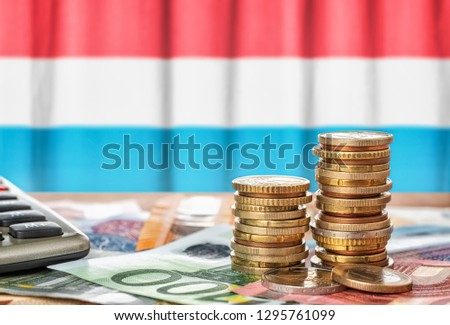 Euro banknotes and coins in front of the national flag of Sloven Stock photo © Zerbor