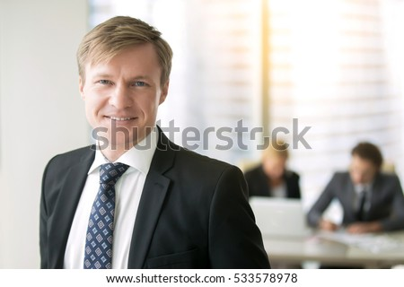 Group of confident financial directors having meeting in boardroom Stock photo © pressmaster