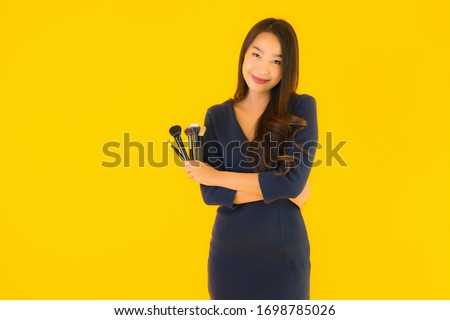 portrait of a beautiful young brunette woman with shiny straight stock photo © dashapetrenko