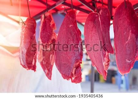 Sausages. Sausages hang outdoor for sale on a street market.Home made meat salami sausage at street  Stock photo © galitskaya