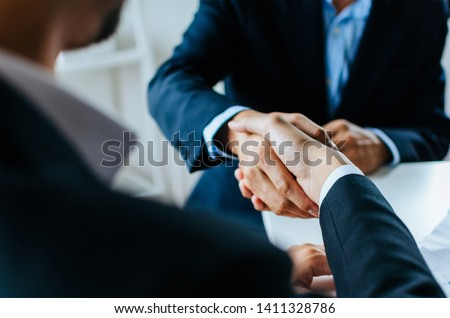 Business handshake after agreement meeting or negotiation finish Stock photo © snowing