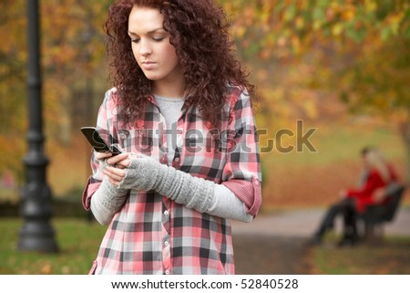 frustrated teenage girl making mobile phone call in autumn lands stock photo © monkey_business