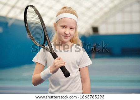 Pretty young woman in activewear holding ball for playing basketball Stock photo © pressmaster