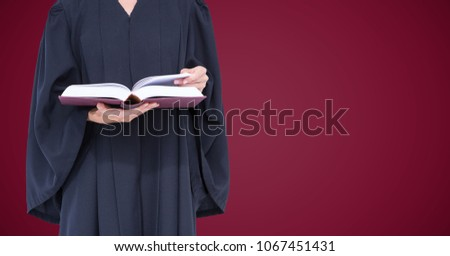 Female judge mid section with open book against maroon background Stock photo © wavebreak_media