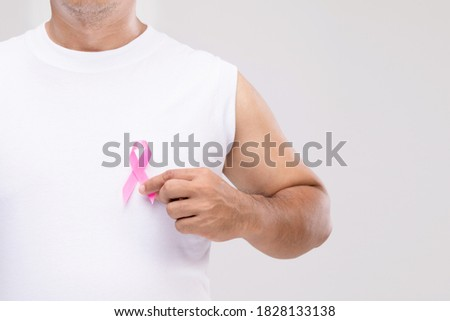 Doctor man with breast cancer awareness ribbon Stock photo © wavebreak_media