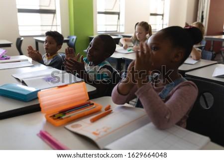 Yandan görünüş oturma büro sınıf Stok fotoğraf © wavebreak_media