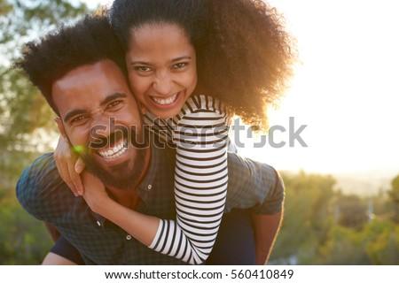Ver feliz piggyback brasão Foto stock © wavebreak_media