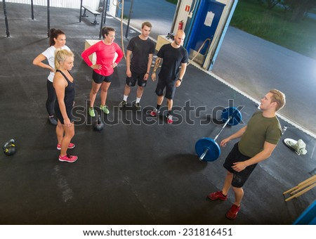 High angle view of young female trainer exercising with senior people in fitness studio Stock photo © wavebreak_media