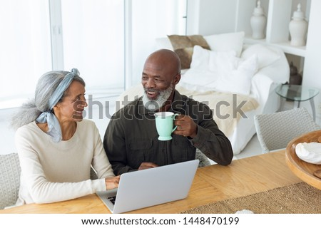 front view of active senior man using laptop while sitting on a bench in the park stock photo © wavebreak_media