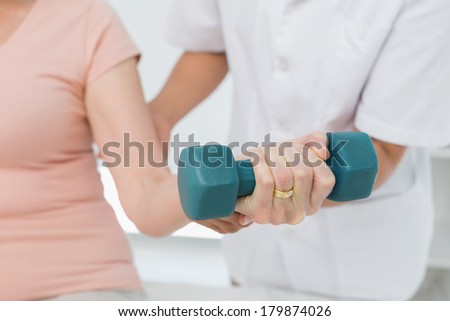 Mid section of senior woman exercising with dumbbells and sitting on exercice ball in the park Stock photo © wavebreak_media