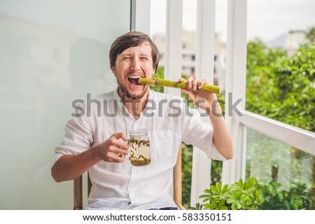 Canne sucre homme manger canne boissons Photo stock © galitskaya